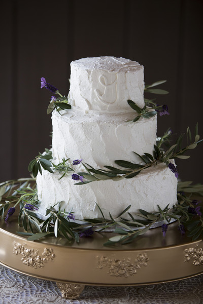 The Wedding Cake Was Simply Decorated With White Buttercream Frosting And Greenery Catering