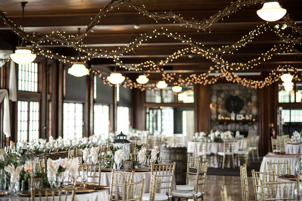 Guests Sat At Round Tables In Gold Chiavari Chairs Underneath Twinkling String Lights Venue