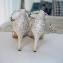"<strong class='info-row'>Joanna Tano Photography</strong> <div class='info-row description'><html>  <head></head>  <body>    ""I do"" was spelled out with rhinestones on the heels of each shoe.   Venue: White Orchid Beach House from    <a href=""https://www.weddingwire.com/biz/a-white-orchid-wedding-inc-wailuku/613a4afe72f6cb8d.html"" target=""_blank"">A White Orchid Wedding, Inc.</a>   </body> </html></div>"