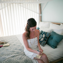 "<strong class='info-row'>Joanna Tano Photography</strong> <div class='info-row description'><html>  <head></head>  <body>    The bride took a moment, while getting ready, to write her soon-to-be husband a special note.   Venue: White Orchid Beach House from    <a href=""https://www.weddingwire.com/biz/a-white-orchid-wedding-inc-wailuku/613a4afe72f6cb8d.html"" target=""_blank"">A White Orchid Wedding, Inc.</a>  Hair and Makeup: Maui Beautiful Brides   </body> </html></div>"