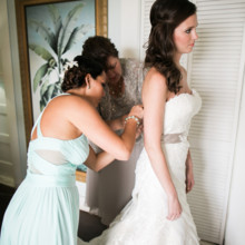 "<strong class='info-row'>Joanna Tano Photography</strong> <div class='info-row description'><html>  <head></head>  <body>    Ashley's mom and maid of honor help put the finishing touches on her elegant look.  Venue: White Orchid Beach House from    <a href=""https://www.weddingwire.com/biz/a-white-orchid-wedding-inc-wailuku/613a4afe72f6cb8d.html"" target=""_blank"">A White Orchid Wedding, Inc.</a>  Hair and Makeup: Maui Beautiful Brides   </body> </html></div>"