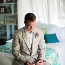 "<strong class='info-row'>Joanna Tano Photography</strong> <div class='info-row description'><html>  <head></head>  <body>    Matt can't help but smile as he reads her words.   Venue: White Orchid Beach House from    <a href=""https://www.weddingwire.com/biz/a-white-orchid-wedding-inc-wailuku/613a4afe72f6cb8d.html"" target=""_blank"">A White Orchid Wedding, Inc.</a>  Floral Design:    <a href=""https://www.weddingwire.com/reviews/teresa-sena-designs-kula/e68fec6403a0ee30.html"" target=""_blank"">Teresa Sena Designs</a>   </body> </html></div>"