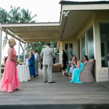 "<strong class='info-row'>Joanna Tano Photography</strong> <div class='info-row description'><html>  <head></head>  <body>    Guests mingled on the front porch of the beach house while waiting for the festivities to start.   Venue: White Orchid Beach House from    <a href=""https://www.weddingwire.com/biz/a-white-orchid-wedding-inc-wailuku/613a4afe72f6cb8d.html"" target=""_blank"">A White Orchid Wedding, Inc.</a>   </body> </html></div>"