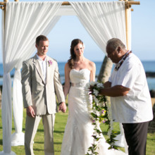 "<strong class='info-row'>Joanna Tano Photography</strong> <div class='info-row description'><html>  <head></head>  <body>    The officiant presented Ashley and Matt with flower leis.  Venue: White Orchid Beach House from    <a href=""https://www.weddingwire.com/biz/a-white-orchid-wedding-inc-wailuku/613a4afe72f6cb8d.html"" target=""_blank"">A White Orchid Wedding, Inc.</a>  Hair and Makeup: Maui Beautiful Brides  Floral Design:    <a href=""https://www.weddingwire.com/reviews/teresa-sena-designs-kula/e68fec6403a0ee30.html"" target=""_blank"">Teresa Sena Designs</a>  Officiant:    <a href=""https://www.weddingwire.com/reviews/reverend-alapaki-terry/a51f1c38de47ddae.html"" target=""_blank"">Reverend Alapaki Terry</a>   </body> </html></div>"