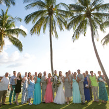 "<strong class='info-row'>Joanna Tano Photography</strong> <div class='info-row description'><html>  <head></head>  <body>    All the wedding guests gathered after the ceremony to snap a quick pic with the happy couple.  Venue: White Orchid Beach House from    <a href=""https://www.weddingwire.com/biz/a-white-orchid-wedding-inc-wailuku/613a4afe72f6cb8d.html"" target=""_blank"">A White Orchid Wedding, Inc.</a>   </body> </html></div>"