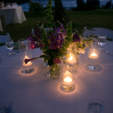 "<strong class='info-row'>Joanna Tano Photography</strong> <div class='info-row description'><html>  <head></head>  <body>    Votive candles illuminated floral centerpieces after the sun went down.   Venue: White Orchid Beach House from    <a href=""https://www.weddingwire.com/biz/a-white-orchid-wedding-inc-wailuku/613a4afe72f6cb8d.html"" target=""_blank"">A White Orchid Wedding, Inc.</a>  Floral Design:    <a href=""https://www.weddingwire.com/reviews/teresa-sena-designs-kula/e68fec6403a0ee30.html"" target=""_blank"">Teresa Sena Designs</a>   </body> </html></div>"