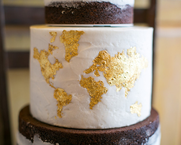 Hollywood glam modern romantic brown gold white buttercream to incorporate the couples love of travel a world map was embossed on one of gumiabroncs Gallery