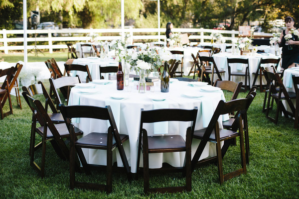 Formal modern rustic blue brown green white california round banquet tables draped with white and light blue linens were surrounded with dark junglespirit Images