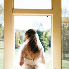 """<strong class='info-row'>Erin Morrison Photography</strong> <div class='info-row description'><html>  <head></head>  <body>    For the big day, the bride wore her hair in a half-up style complete with a simple tulle veil.  Venue: Tuckaway Cove  Bride's Gown:   <a href=""""https://www.weddingwire.com/reviews/sarah-seven-san-francisco/a18db1e5e4af988f.html"""" target=""""_blank"""">Sarah Seven</a>from   <a href=""""https://www.weddingwire.com/biz/the-dress-theory-seattle/eacb4ac349379587.html"""" target=""""_blank"""">The Dress Theory</a>   </body> </html></div>"""
