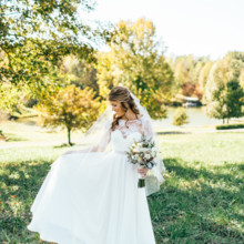 """<strong class='info-row'>Erin Morrison Photography</strong> <div class='info-row description'><html>  <head></head>  <body>    She looked beautiful in her flowing sheath gown with a lace illusion neckline, elbow-length sleeves and a satin sash.  Venue: Tuckaway Cove  Bride's Gown:   <a href=""""https://www.weddingwire.com/reviews/sarah-seven-san-francisco/a18db1e5e4af988f.html"""" target=""""_blank"""">Sarah Seven</a>from   <a href=""""https://www.weddingwire.com/biz/the-dress-theory-seattle/eacb4ac349379587.html"""" target=""""_blank"""">The Dress Theory</a>  Floral Design: Kroger   </body> </html></div>"""