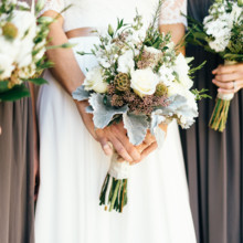 """<strong class='info-row'>Erin Morrison Photography</strong> <div class='info-row description'><html>  <head></head>  <body>    The bouquets included scabiosa pods, roses, lisianthus, seeded eucalyptus, dusty miller, and stock.  Venue: Tuckaway Cove  Bride's Gown:   <a href=""""https://www.weddingwire.com/reviews/sarah-seven-san-francisco/a18db1e5e4af988f.html"""" target=""""_blank"""">Sarah Seven</a>from   <a href=""""https://www.weddingwire.com/biz/the-dress-theory-seattle/eacb4ac349379587.html"""" target=""""_blank"""">The Dress Theory</a>  Floral Design: Kroger   </body> </html></div>"""