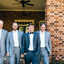 <strong class='info-row'>Erin Morrison Photography</strong> <div class='info-row description'><html>  <head></head>  <body>    His groomsmen wore light gray suits and matching bow ties.  Venue: Tuckaway Cove   </body> </html></div>