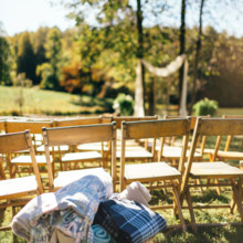 <strong class='info-row'>Erin Morrison Photography</strong> <div class='info-row description'><html>  <head></head>  <body>    Cozy fleece blankets were on hand in case guests got chilly during the ceremony.  Venue: Tuckaway Cove   </body> </html></div>