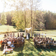 <strong class='info-row'>Erin Morrison Photography</strong> <div class='info-row description'><html>  <head></head>  <body>    Could this riverfront ceremony spot be any prettier?  Venue: Tuckaway Cove   </body> </html></div>