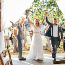 """<strong class='info-row'>Erin Morrison Photography</strong> <div class='info-row description'><html>  <head></head>  <body>    The newlyweds make their grand entrance!  Venue: Tuckaway Cove  Bride's Gown:   <a href=""""https://www.weddingwire.com/reviews/sarah-seven-san-francisco/a18db1e5e4af988f.html"""" target=""""_blank"""">Sarah Seven</a>from   <a href=""""https://www.weddingwire.com/biz/the-dress-theory-seattle/eacb4ac349379587.html"""" target=""""_blank"""">The Dress Theory</a>  Floral Design: Kroger   </body> </html></div>"""
