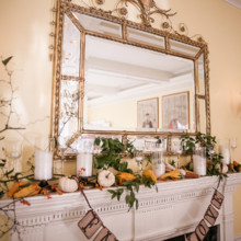 "<strong class='info-row'>Femina Photo + Design</strong> <div class='info-row description'><html>  <head></head>  <body>    A mantel was adorned with candles, gourds, greenery, and pumpkins, along with a ""Fall in Love"" banner.  Venue:    <a href=""https://www.weddingwire.com/biz/dupont-country-club-and-brantwyn-estate-wilmington/4c1b5d56634cbc07.html"">Brantwyn Estate</a>  Floral Design:    <a href=""https://www.weddingwire.com/biz/a-garden-party-elmer/7f876b0ec1188a61.html"">A Garden Party</a>   </body> </html></div>"