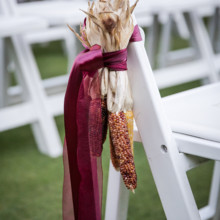 "<strong class='info-row'>Femina Photo + Design</strong> <div class='info-row description'><html>  <head></head>  <body>    Aisle markers featured decorate corn tied with burgundy satin ribbon.   Venue:    <a href=""https://www.weddingwire.com/biz/dupont-country-club-and-brantwyn-estate-wilmington/4c1b5d56634cbc07.html"">Brantwyn Estate</a>  Floral Design:    <a href=""https://www.weddingwire.com/biz/a-garden-party-elmer/7f876b0ec1188a61.html"">A Garden Party</a>   </body> </html></div>"