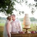 130x130 sq 1470937622 cefb6adfb9f46dd3 bride and groom with cake