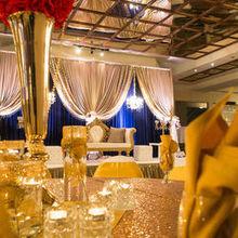 220x220 sq 1508952215 473b9afe7663d2b6 joya hall gold blue stage and table setting