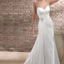 Sonora Dazzling crystals traverse an illusion back in this eye catching gown of Paris Chiffon. Asymmetrical draping across the body creates a captivating sheath adorned with jewelry inspired straps and Swarovski crystal embellished motif. Sweetheart neckline with crystal button over zipper closure.