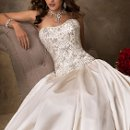 Zander - 22623  <br /> A magnificent ball gown in two pieces, this Soft Shimmer Satin will surprise you. Easy to wear, flattering to the figure, a beauty to behold; strapless bodice features Swarovski crystals richly strewn throughout and corset back closure. Ball gown skirt is finished with corset back closure.