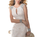 Ellie  This elegant lace gown plays up the glamour of old Hollywood. Jeweled shoulders, accented with Swarovski crystals and a keyhole neckline offer a fresh twist on a timeless classic. Finished with zipper back closure.