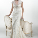 Odette Stunning beaded embroidered lace with metallic accents and Swarovski crystals on Glitter tulle sheath overlays a separate Orlando satin slip dress, accented with keyhole back. Finished with crystal buttons over zipper closure.
