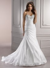 Aimee - V7136 <br /> Elegantly glamorous, the deep sweetheart neckline is accentuated by boldly encrusted Swarovski crystals in this Bordeaux Taffeta fit and flare silhouette, finished with a balloon hem, dazzling beaded embellishment at the hip, and corset closure.
