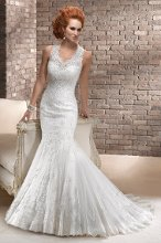 Eleanor <br /> This lavish tulle and embellished lace gown with optional matching veil is the perfect ensemble for an epic romance. The form fitting silhouette features an illusion neckline artfully transitioning into a captivating keyhole back. Finished with covered button over zipper closure.