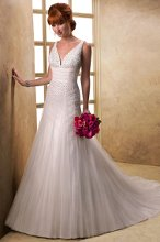 Bree - 12933V  <br /> Stunning sequined tulle design with deep V-neckline and gorgeous fit and flare skirt featuring tulle godets throughout. Finished with covered button closure over inner corset. Available with sequined tulle veil.
