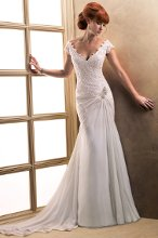 Blossom - 21703  A subtle, yet splendid work of art in corded lace and Paris Chiffon draped over Romance Satin, this sheath gown is reminiscent of Grecian royalty. Details include a beaded motif with Swarovski crystals ornamenting the hip, deep-V neckline and covered button over zipper closure.