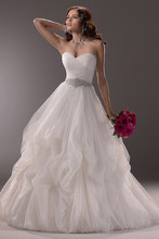 Chimere  The belle of the ball will take center stage in this tulle ballgown, with beautifully ruched fabric on the bodice. Finished with sweetheart neckline and signature corset closure. Also available with zipper over inner corset back closure.