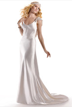 Emilena  Capture the essence of vintage chic in this bias-cut Vienna Crepe Back Satin slip gown, featuring a dramatic open back trimmed in sequin embellished lace. Finished with V-neckline. Dress includes matching lace hairpiece on satin ribbon.