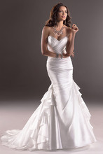 Skylar  Perfect for the bride who wants a dress with a little more pizzazz, this fit and flare Valencia Organza gown features exquisite asymmetrical folds. Finished with a strapless sweetheart neckline and signature corset back closure.