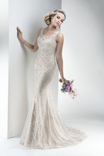 Indiana  Intricate beaded embroidery with shimmering metallic threading and dazzling Swarovski crystals adorn this lightweight tulle sheath with stunning illusion keyhole back. Finished with zipper closure.
