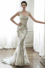 Jade  Exquisite bead embroidered lace adorns the bodice in this sheath wedding dress with Swarovski crystal neckline. Complete with stunning double keyhole back. Finished with zipper closure.