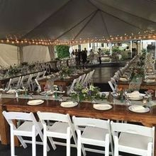 220x220 sq 1484054656 18e8d6fafa4b22bc 1483977391671 farm table tent set up