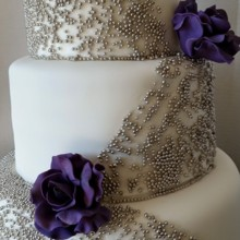 220x220 sq 1484264552545 beaded purple rose wedding