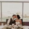 96x96 sq 1501519675295 wedding couple kiss