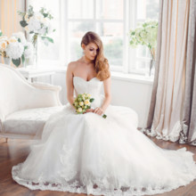 220x220 sq 1512501186031 wedding. bride in beautiful dress sitting on sofa