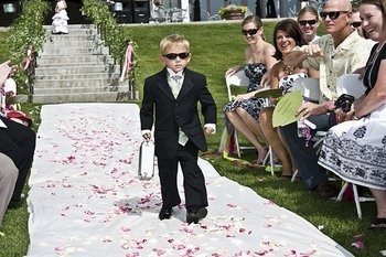 My FH wants our ring bearer to carry a briefcase and look like the secret service with the white earpiece in his ear.