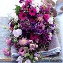 130x130 sq 1319919557048 bouquetinallshadesofpurple250x250