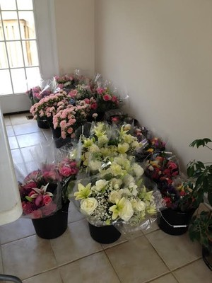 my mom bought all these flowers in bulk from costco and arranged them with my aunt it was her gift to us and the flowers were incredible