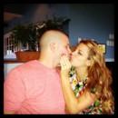 130x130 sq 1390442680568 engagement kiss 201