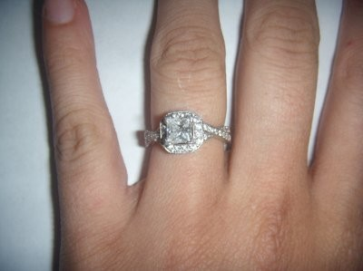 Mine is 3/4 carat center stone and 1 carat total. I love it! and I love  this thread, all the rings are sooo gorgeous!