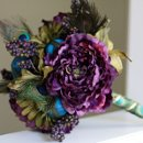 130x130_sq_1297124381502-weddingbouquetpurple2