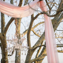 Photo for JL Designs Review - Close-up of the chandelier and fabric ceremony backdrop