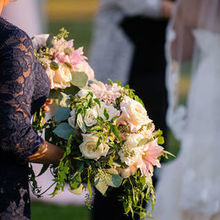 Photo for JL Designs Review - MOH holding both of our bouquets