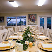 Photo for JL Designs Review - Reception table decorated with floral garland and candles.