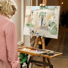 Photo of Live Event Portrait Artist Ann Bailey in Roswell, GA - Painting during the reception